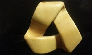 "Mobius strip out of 2"" thick yellow cedar at Parm"